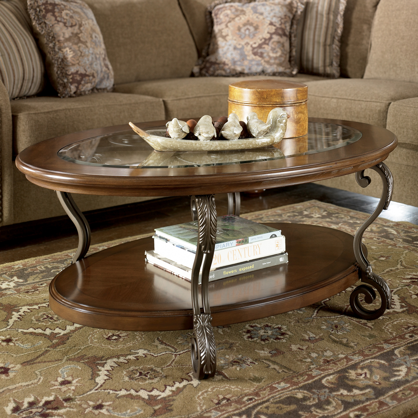 Signature Design by Ashley Nestor Oval Cocktail Table - Medium Brown